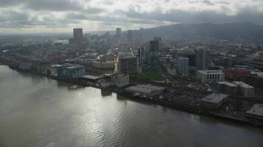 6K stock footage aerial video flying over the Willamette River toward Downtown Portland, Oregon Aerial Stock Footage | AX153_044