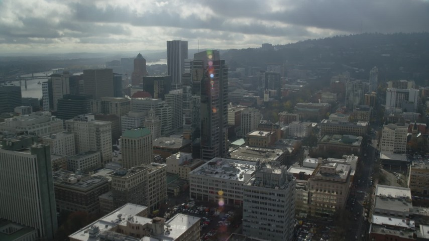 6K stock footage aerial video flying by skyscrapers and high-rises, partly cloudy, Downtown Portland, Oregon Aerial Stock Footage | AX153_047