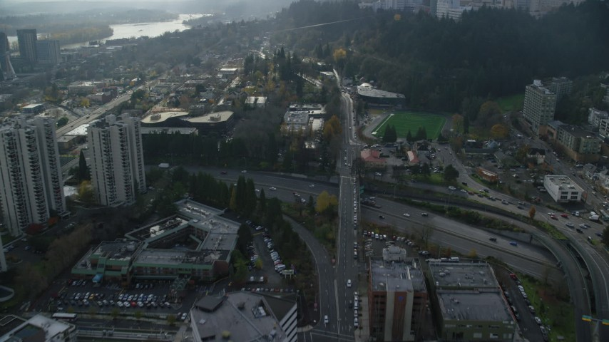 6K stock footage aerial video flying over freeway through Downtown Portland, Oregon Aerial Stock Footage | AX153_049