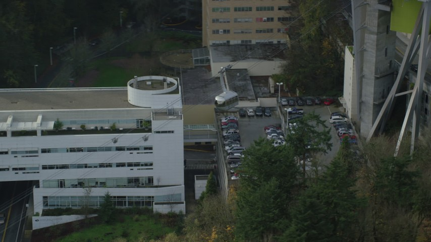 6K aerial video flying over a gondola at the Oregon Health and Science University, autumn, Portland, Oregon Aerial Stock Footage | AX153_050