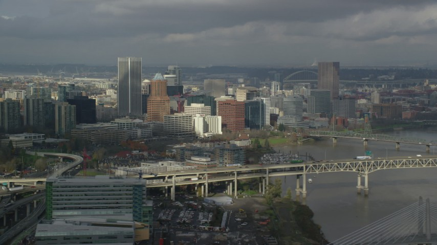 6K stock footage aerial video crossing the Willamette River with views of the city skyline, autumn, Downtown Portland, Oregon Aerial Stock Footage | AX153_051