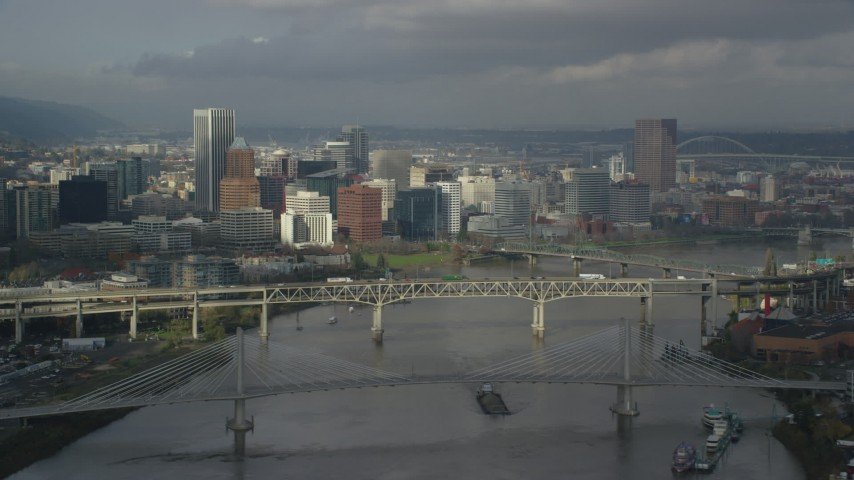6K stock footage aerial video crossing Willamette River with views of Downtown skyline, autumn, Downtown Portland, Oregon Aerial Stock Footage | AX153_052
