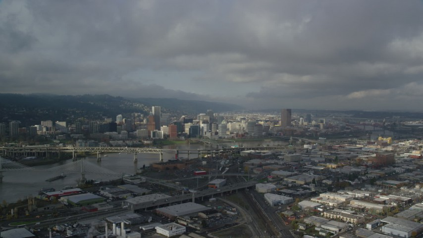6K stock footage aerial video flying over industrial area toward river and downtown, autumn, Downtown Portland, Oregon Aerial Stock Footage | AX153_053