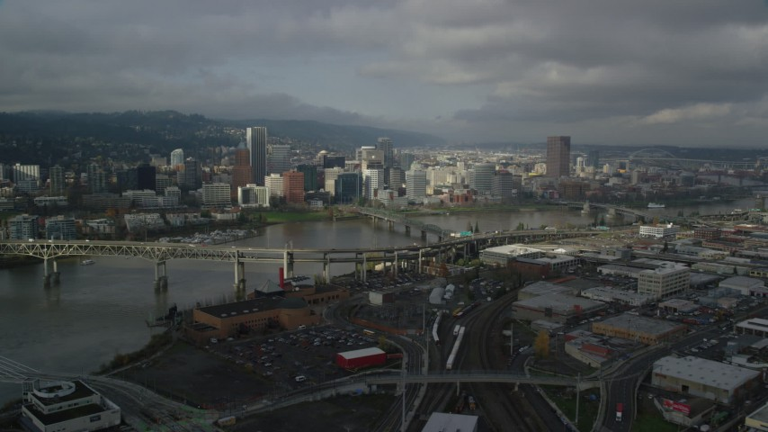6K stock footage aerial video flying over Marquam Bridge toward skyline, Downtown Portland, Oregon Aerial Stock Footage | AX153_054
