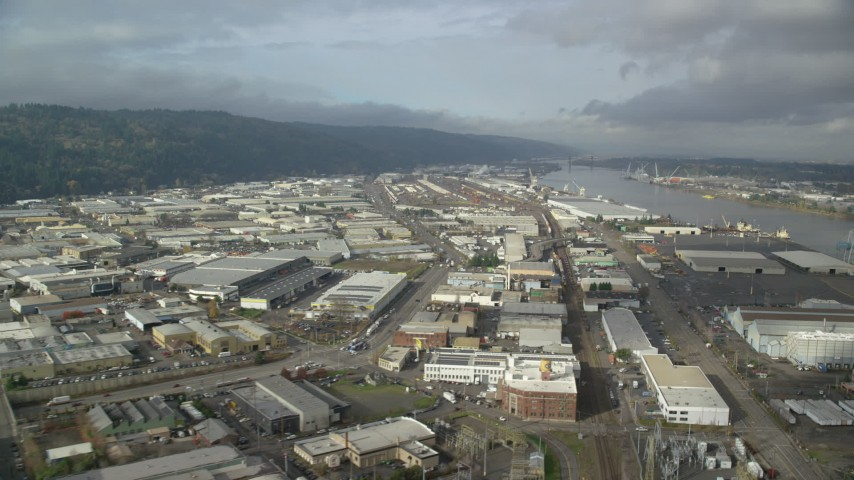 6K aerial video flying by warehouses along the river, autumn, Northwest Portland, Oregon Aerial Stock Footage | AX153_059