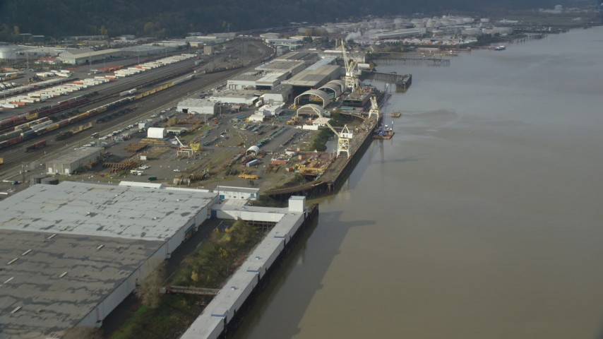 6K stock footage aerial video flying along a shipping area on the river, Northwest Portland, Oregon Aerial Stock Footage | AX153_061