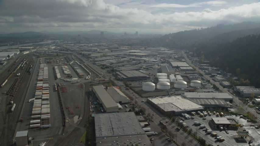 6K stock footage aerial video flying over shipping containers and warehouses, Northwest Portland, Oregon Aerial Stock Footage | AX153_064
