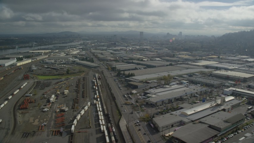 6K stock footage aerial video flying over warehouses toward Downtown Portland, Oregon Aerial Stock Footage | AX153_065