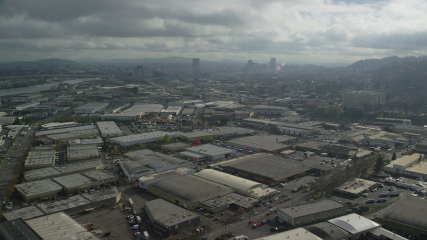 6K stock footage aerial video flying over warehouses and parking lots, Portland, Oregon Aerial Stock Footage   AX153_066