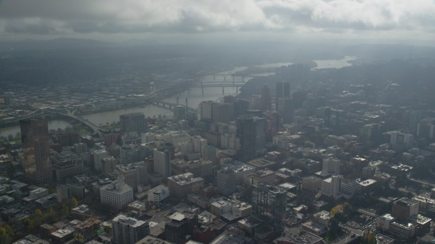 6K stock footage aerial video of bridges over the Willamette River and skyscrapers in Downtown Portland, Oregon Aerial Stock Footage | AX153_077