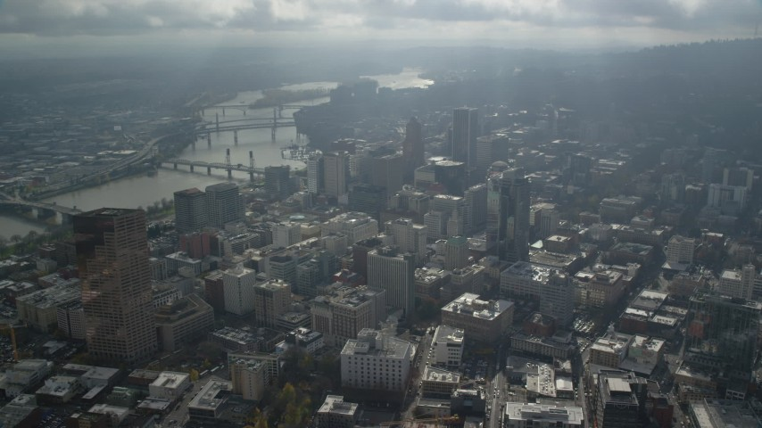 6K stock footage aerial video bridges over the Willamette River and Skyscrapers in Downtown Portland, Oregon Aerial Stock Footage | AX153_078