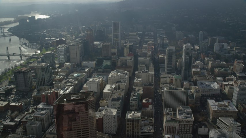 6K stock footage aerial video flying by skyscrapers in Downtown Portland, Oregon Aerial Stock Footage AX153_079 | Axiom Images
