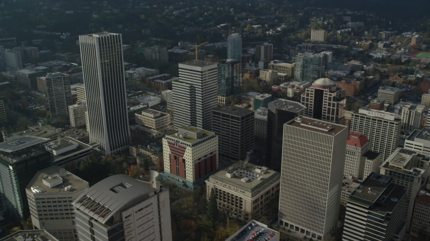 6K stock footage aerial video orbiting Wells Fargo Center and skyscrapers in Downtown Portland, Oregon Aerial Stock Footage | AX153_081