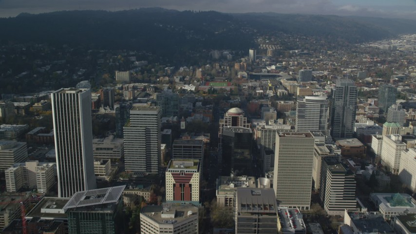 6K stock footage aerial video flying over skyscrapers to approach high school sports field in Downtown Portland, Oregon Aerial Stock Footage | AX153_085