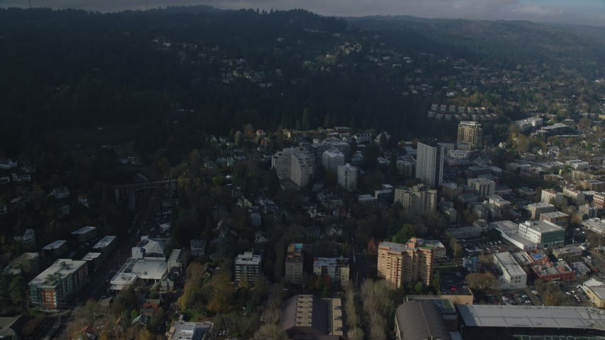 6K stock footage aerial video flying over Goose Hollow apartment buildings to approach Arlington Heights homes in Portland, Oregon Aerial Stock Footage | AX153_087