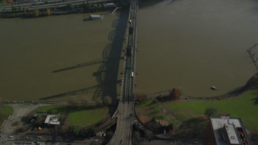 Bird's eye view of the Hawthorne Bridge, reveal Interstate 5 in Downtown Portland, Oregon Aerial Stock Footage | AX153_090
