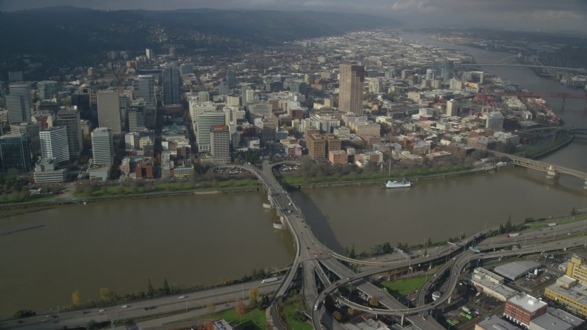 6K aerial video of Downtown skyscrapers seen from the Morrison Bridge in Downtown Portland, Oregon Aerial Stock Footage | AX153_092