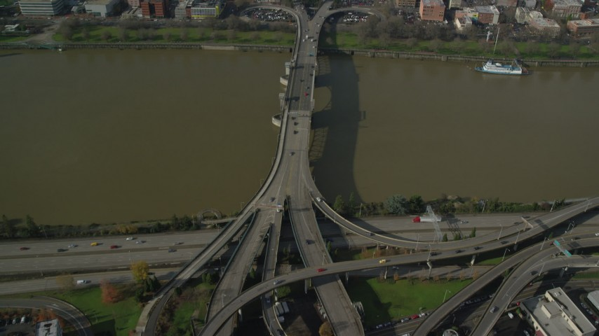 6K stock footage aerial video tilting from Morrison Bridge to reveal and approach Downtown Portland, Oregon Aerial Stock Footage   AX153_093