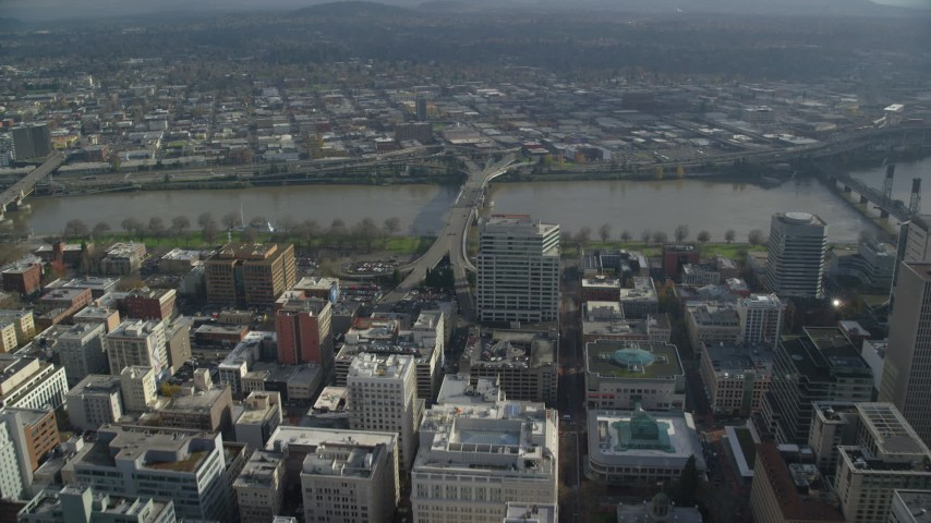 6K stock footage aerial video approaching and flying over the Morrison Bridge in Downtown Portland, Oregon Aerial Stock Footage | AX153_099