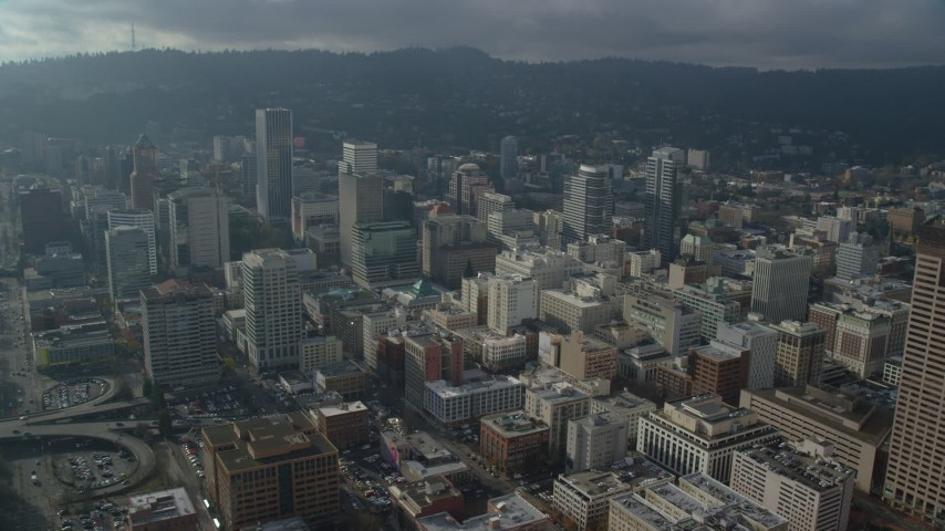 6K stock footage aerial video passing skyscrapers in Downtown Portland, Oregon Aerial Stock Footage | AX153_106