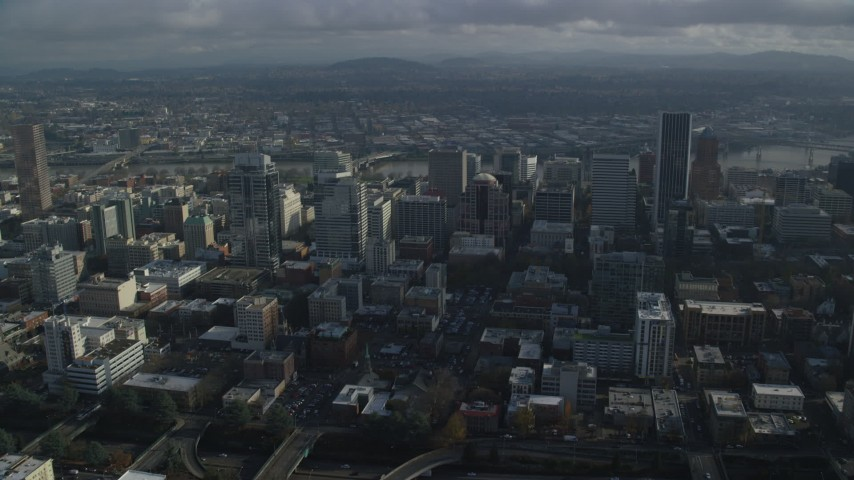 6K stock footage aerial video of skyscrapers and the Willamette River in Downtown Portland, Oregon Aerial Stock Footage | AX153_109