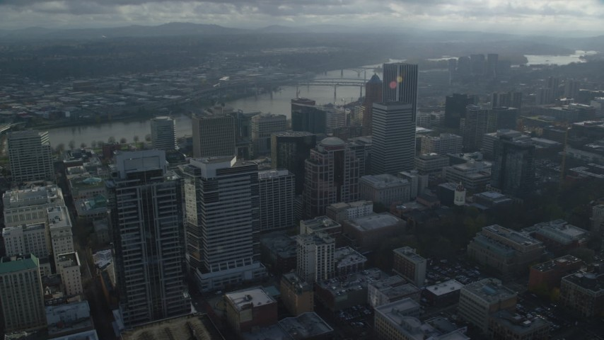 6K stock footage aerial video of skyscrapers and bridges spanning the Willamette River in Downtown Portland, Oregon Aerial Stock Footage AX153_110 | Axiom Images