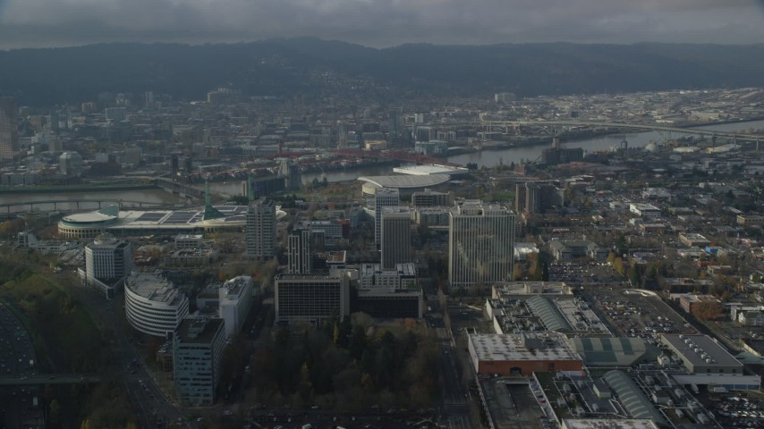 6K stock footage aerial video orbiting office buildings and Moda Center with Downtown Portland, Oregon in the background Aerial Stock Footage | AX153_111