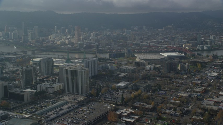 6K stock footage aerial video of Downtown Portland skyscrapers seen from Moda Center in Oregon Aerial Stock Footage | AX153_112
