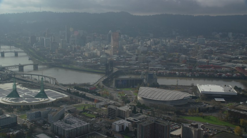 6K stock footage aerial video of skyscrapers in Downtown Portland seen from Moda Center in Oregon Aerial Stock Footage | AX153_113