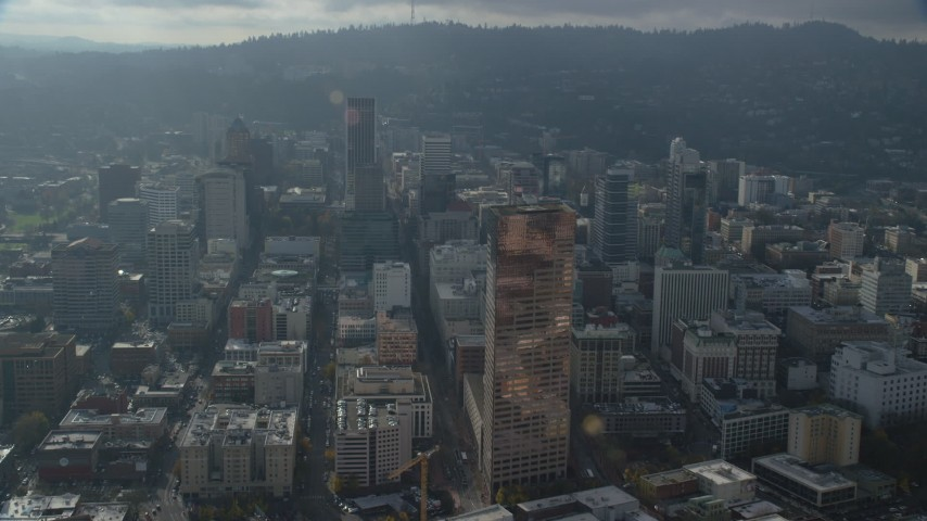 6K stock footage aerial video flying over US Bancorp Tower and follow SW 5th Avenue through Downtown Portland, Oregon Aerial Stock Footage | AX153_116