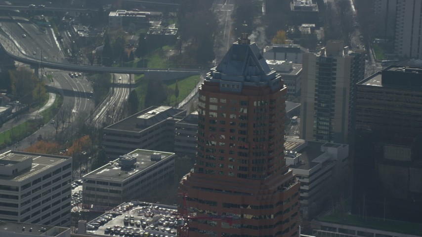 6K stock footage aerial video of steam venting from the roof of KOIN Center in Downtown Portland, Oregon Aerial Stock Footage | AX153_117