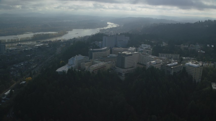 6K stock footage aerial video approaching and fly over the Oregon Health and Science University in Portland, Oregon Aerial Stock Footage | AX153_119