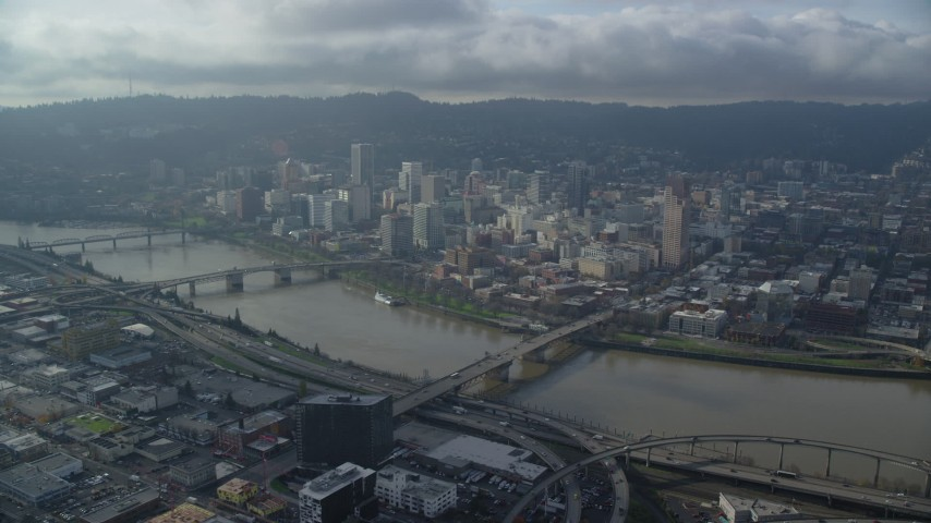 6K stock footage aerial video approaching US Bancorp Tower and skyscrapers in Downtown Portland, Oregon Aerial Stock Footage | AX153_122