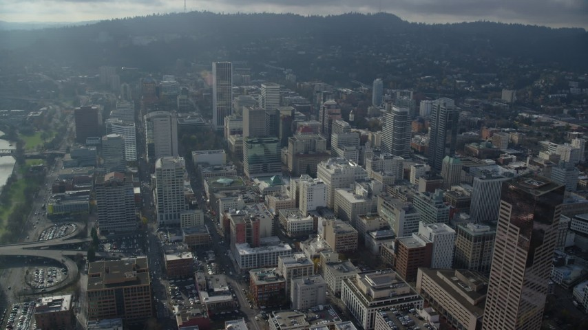 6K stock footage aerial video approaching Wells Fargo Center and skyscrapers in Downtown Portland, Oregon Aerial Stock Footage | AX153_124