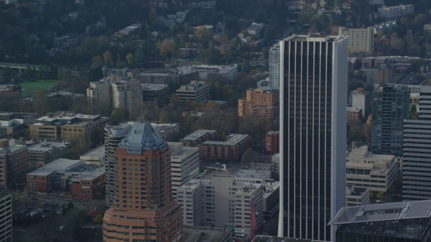 6K stock footage aerial video of KOIN Center and Wells Fargo Center in Downtown Portland, Oregon Aerial Stock Footage | AX153_126