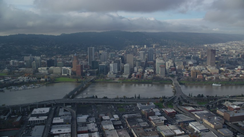 6K stock footage aerial video of bridges spanning Willamette River and skyscrapers in Downtown Portland, Oregon Aerial Stock Footage | AX153_127