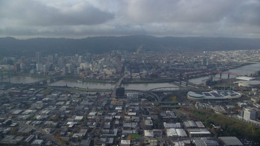 Downtown Portland and Willamette River seen from Lloyd District in Oregon Aerial Stock Footage | AX153_129