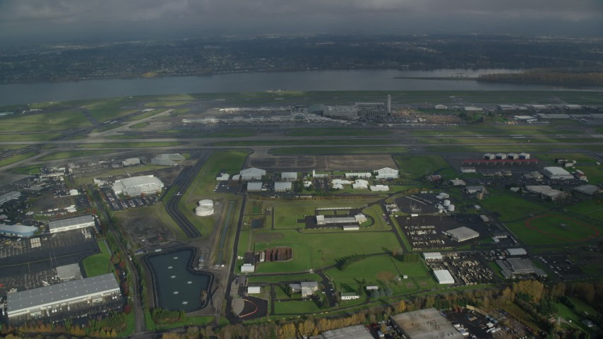 6K stock footage aerial video approaching Portland International Airport and the Columbia River in Oregon Aerial Stock Footage | AX153_133
