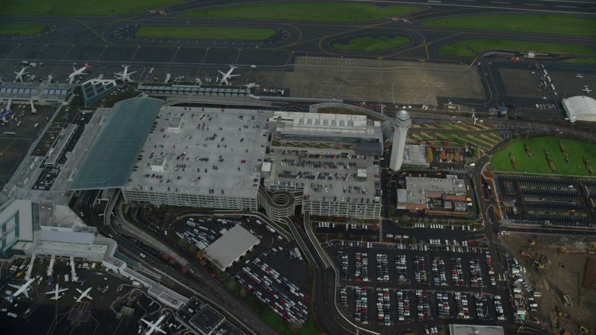 6K stock footage aerial video of a bird's eye view of rooftop parking at Portland International Airport in Oregon Aerial Stock Footage | AX153_135