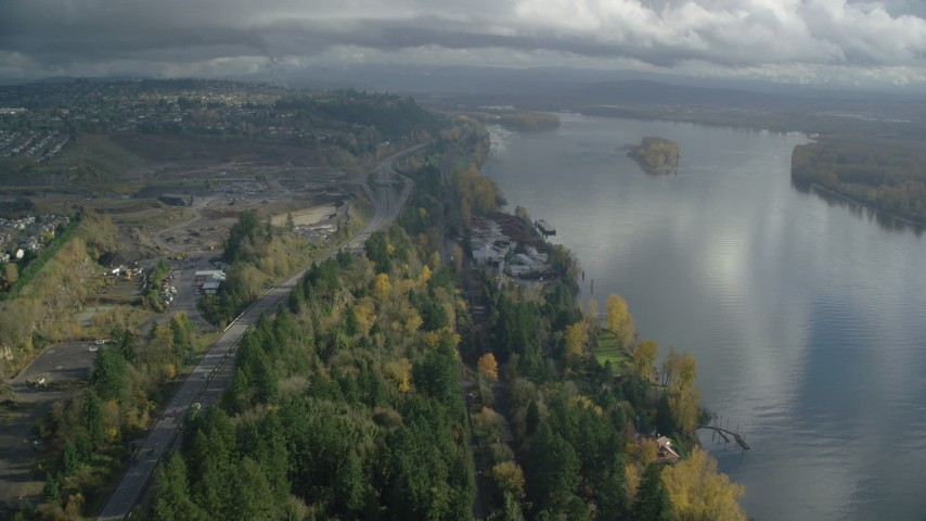 6K stock footage aerial video approaching a lumber mill on the Columbia River near Highway 14, Camas and Vancouver, Washington Aerial Stock Footage | AX153_145