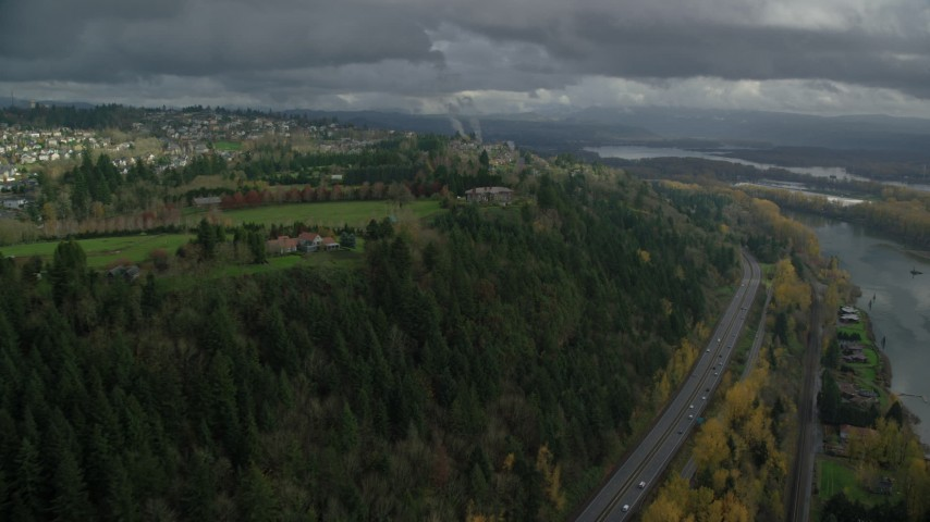6K stock footage aerial video flying by mansions to approach a hilltop suburban neighborhood in Camas, Washington Aerial Stock Footage | AX153_147
