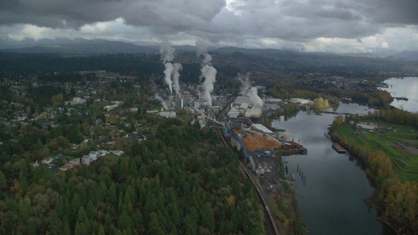6K stock footage aerial video flying by the Georgia Pacific Paper Mill in Camas, Washington Aerial Stock Footage | AX153_151