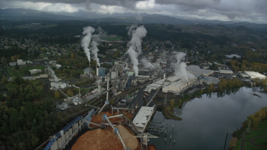 6K stock footage aerial video of steam rising from the Georgia Pacific Paper Mill in Camas, Washington Aerial Stock Footage AX153_152