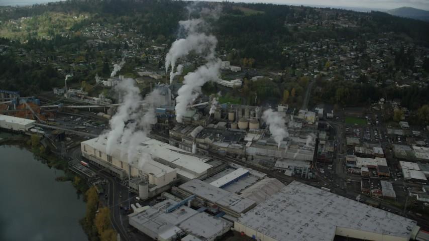 6K stock footage aerial video orbiting the Georgia Pacific Paper Mill, Camas, Washington Aerial Stock Footage AX153_154