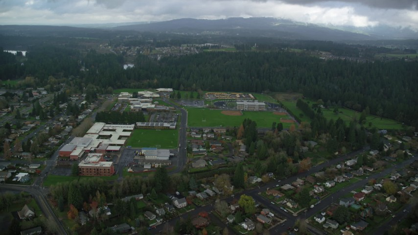 6K stock footage aerial video approaching school campus and sports fields in Camas, Washington Aerial Stock Footage | AX153_155
