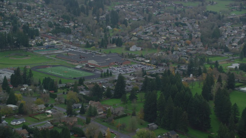 6K stock footage aerial video of Washougal High School and football field in Washougal, Washington Aerial Stock Footage | AX153_165
