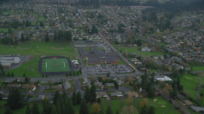 6K stock footage aerial video orbiting Washougal High School and football field in Washougal, Washington Aerial Stock Footage | AX153_166