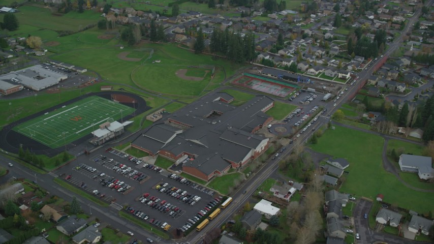 6K stock footage aerial video orbiting Washougal High School and the football field in Washougal, Washington Aerial Stock Footage | AX153_167