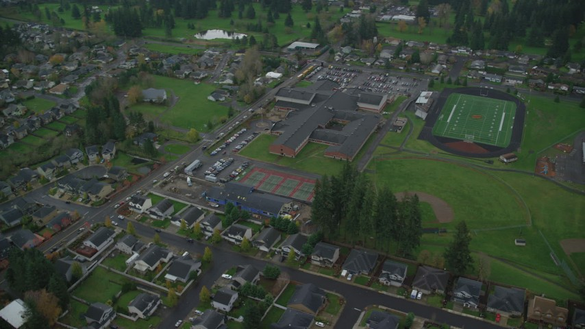 6K stock footage aerial video orbiting Washougal High School and reveal Gause Elementary in Washougal, Washington Aerial Stock Footage | AX153_169