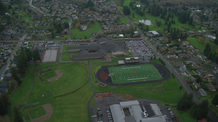 6K stock footage aerial video orbiting Washougal High School and sports fields in Washougal, Washington Aerial Stock Footage | AX153_170